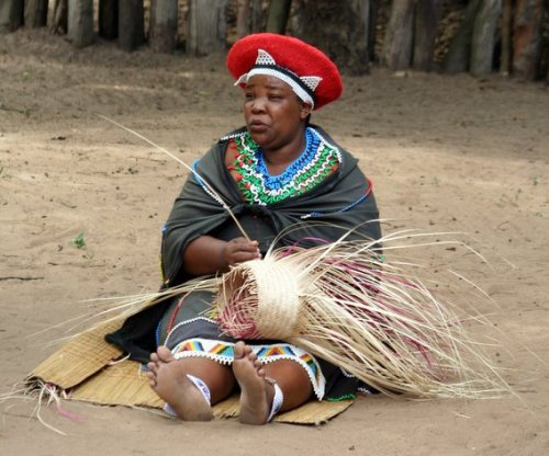 Zulu woman busy weaving